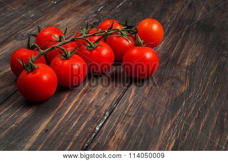 Fresh cherry tomatoes on wood background