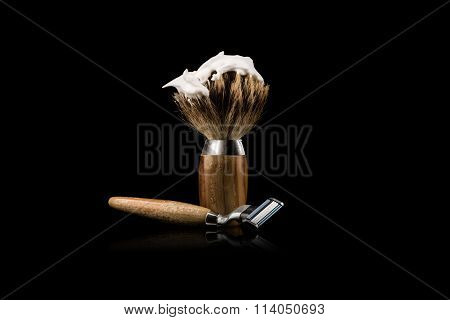 Shaving Brush And Safety Razor On Black Background