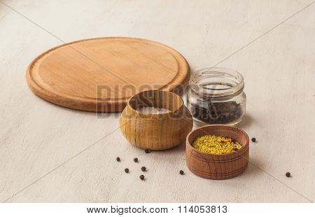Jars With Spices On A Blank Cutting Board