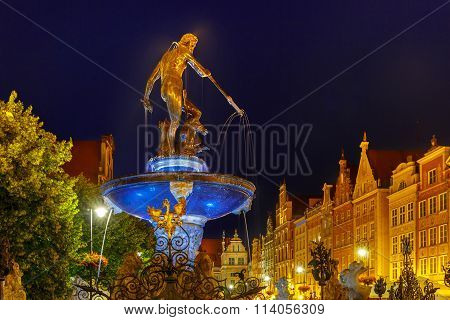 Fountain of Neptune in Gdansk at night, Poland