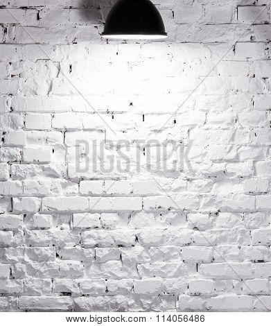 texture of brick whitewashed wall with lamp on top