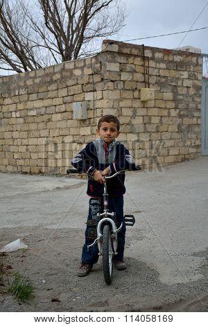 Young lad on bike in outskirts of Baku, capital of Azerbaijan