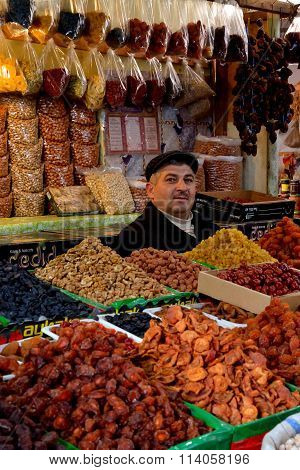 Market seller with dried fruits and nuts in Baku, Azerbaijan