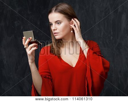 Young Woman Is Looking In To The Mirror
