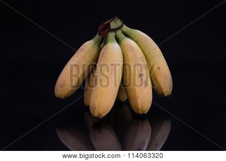 Bananas against black background