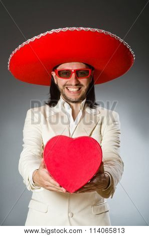 Person wearing sombrero hat in funny concept