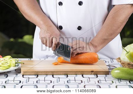 Chef Cutting Carrot
