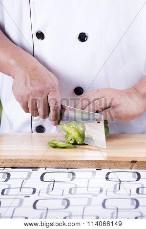 Chef Cutting Green Bell Pepper