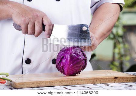 Chef Cutting Purple Cabbage
