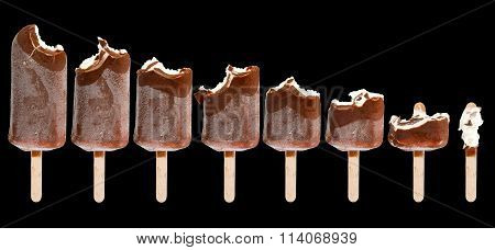 Isolated image of a bitten ice cream on a black background close-up