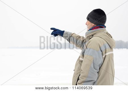 Man Close To The Frozen River In Winter