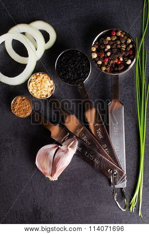 Spices on black background.