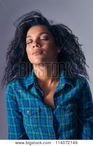 Woman relaxing with closed eyes throwing back