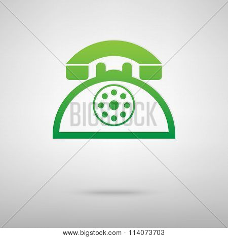Retro telephone. Green icon