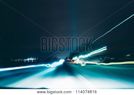 Blurred car lights in the nighttime.