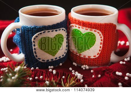 Two warm cups of tea or coffee with heart for Valentine's day