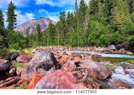 Orange Stones In Line With The Mountain River