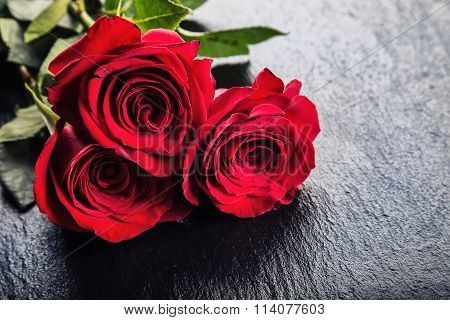 Rose. Red roses.  Bouquet of red roses. Several roses on Granite background. Valentines Day, wedding