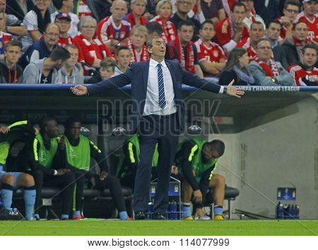 MUNICH, GERMANY - SEPTEMBER 17 2014: Manuel Pellegrini gestures during the UEFA Champions League match between Bayern Munich and Manchester City, at the Allianz Arena, Munich, Germany.