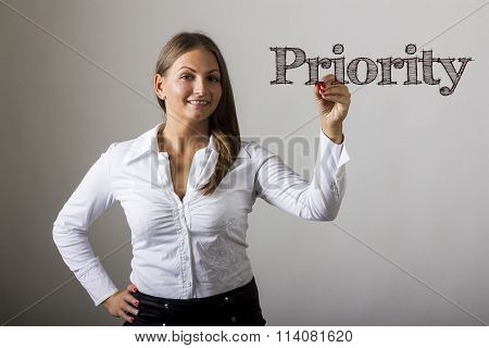 Priority - Beautiful Girl Writing On Transparent Surface
