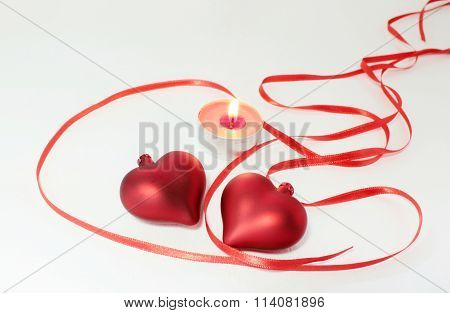 Two hearts and candle decoration for Valentine's Day