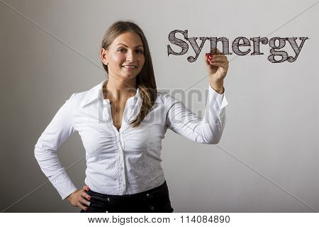 Synergy - Beautiful Girl Writing On Transparent Surface