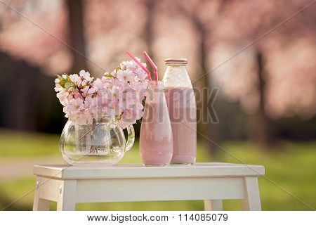 Strawberry Smoothie Freshly Made In A Jar, Forest Spring Flowers In A Vase
