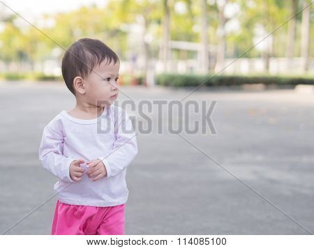 Asian Toddler Stand In Park Outdoor Morning Summer.