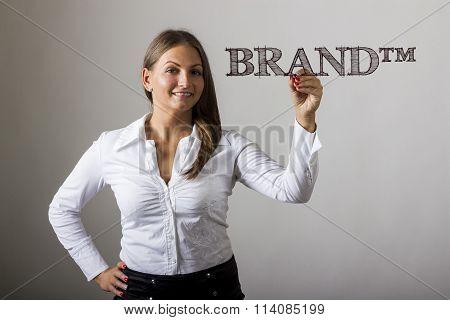 Brand (tm) - Beautiful Girl Writing On Transparent Surface