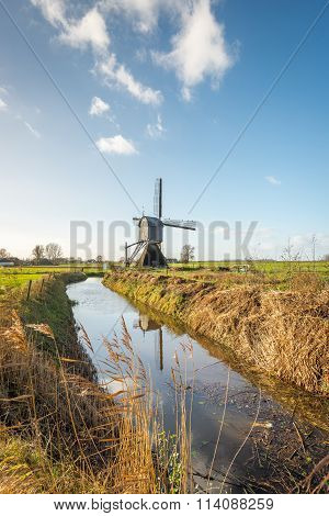 Dutch Polder Mill At The End Of A Stream