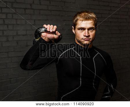Portrait handsome man holding kettlebell weight