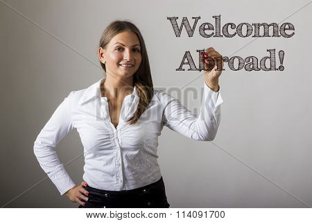Welcome Abroad! - Beautiful Girl Writing On Transparent Surface