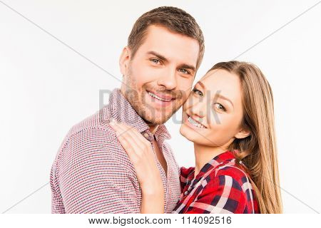 Close Up Photo Of Cheerful Hugging Couple In Love