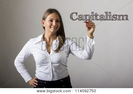 Capitalism - Beautiful Girl Writing On Transparent Surface