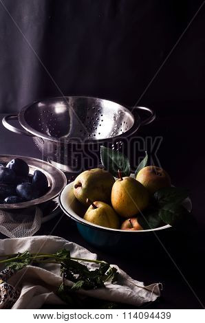 Fresh plums in natural light setting