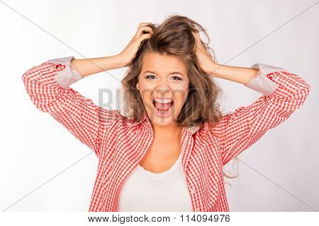 Portrait Of Crazy Cute Girl Shouting And Holding Hair