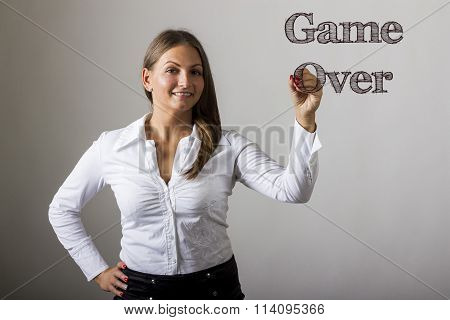 Game Over - Beautiful Girl Writing On Transparent Surface