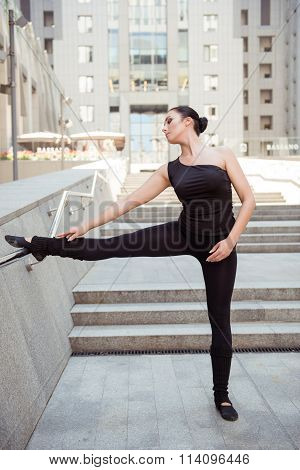 Cute Young Ballerina Standing At The Railing