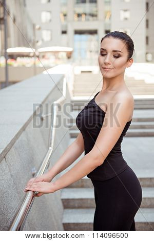 Cute Young Woman Standing At The Railing