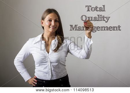 Total Quality Management - Beautiful Girl Writing On Transparent Surface