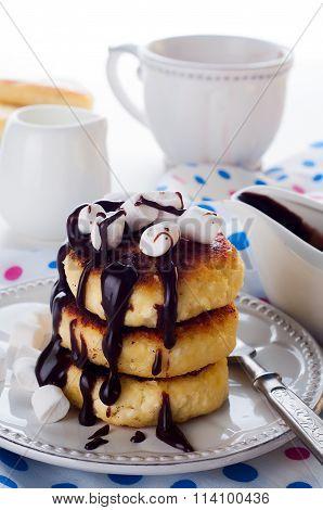 Syrniki cheese pancakes with sour cream