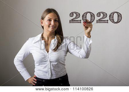 2020 - Beautiful Girl Writing On Transparent Surface