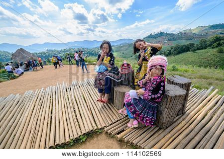Unidentified tribe girls in traditional dress