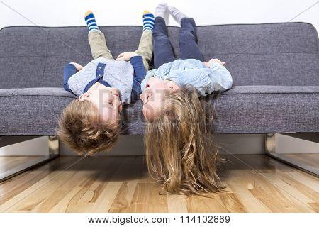two nice child boy and girl on sofa