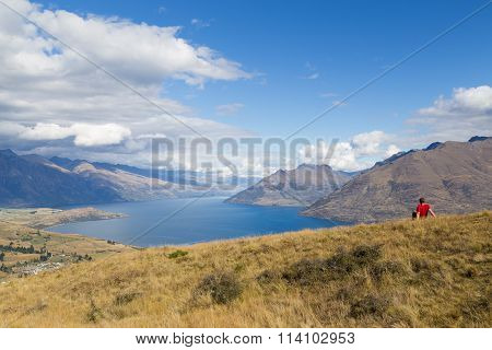 Man enjoying view from Queenstown Hill, New Zealand