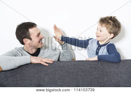 nice closeup of father and son at home