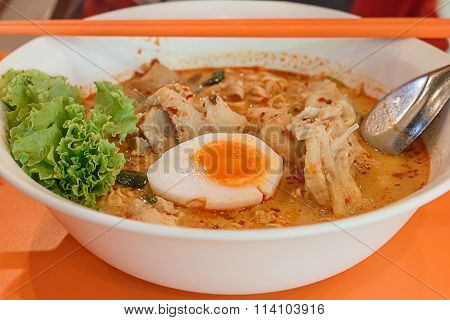 Noodles In Thai Spicy Tom Yum Soup With Egg And Shrimp Wonton