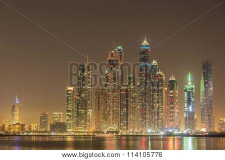 DUBAI - JANUARY 8, 2015: Dubai Marina skyscrapers on January 8 in UAE, DUBAI. Dubai Marina skyscrapers are among the higherst in the world