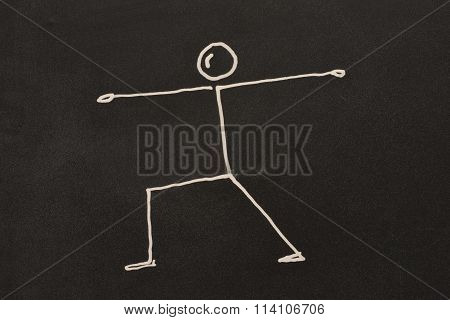 Yoga exercise on blackboard