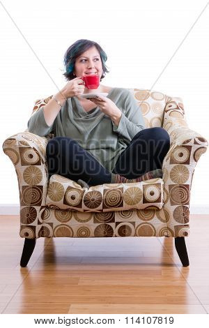 Middle-aged Woman Enjoying Coffee Alone